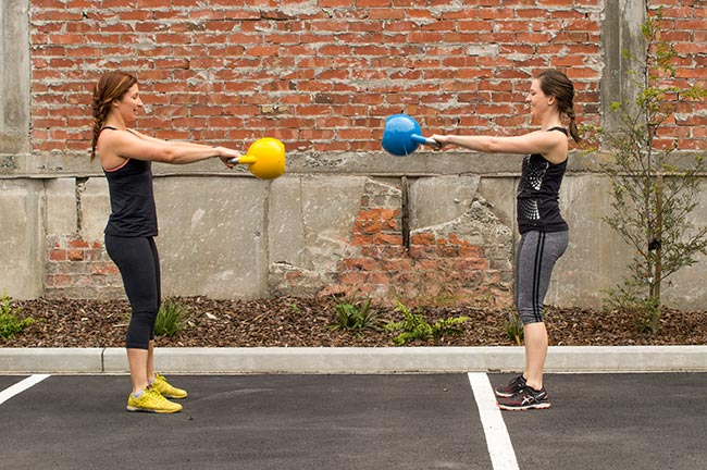 group Crossfit class at a fitness club