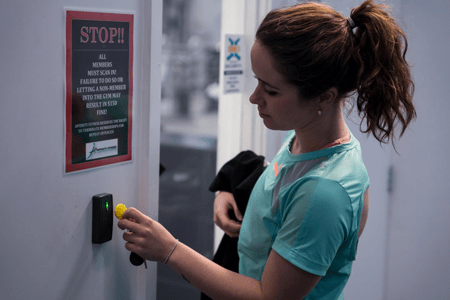 woman using GymMaster gym access control system